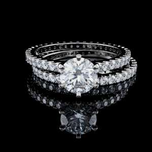 Solitaire diamond engagement ring, eternity wedding band on black background in Mission VIejo